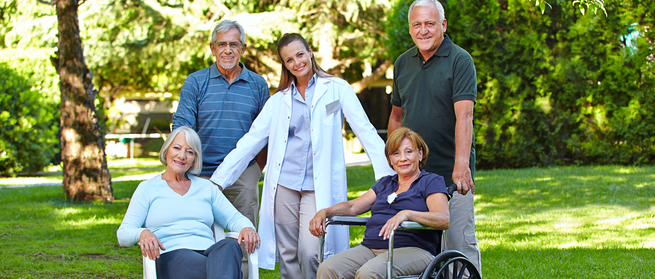 group of seniors and a caregiver