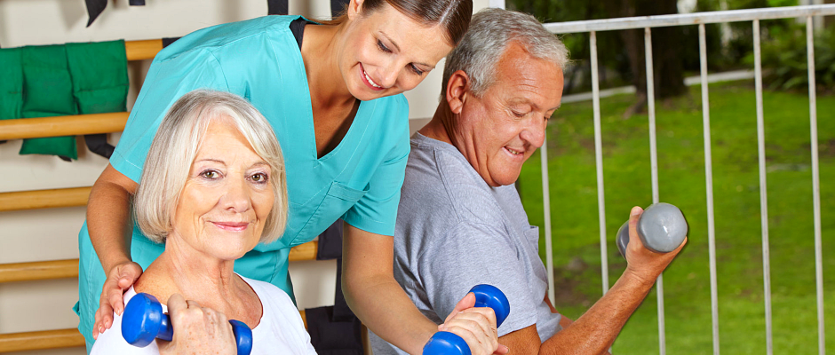 caregiver assisting seniors in exercising