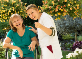 happy senior woman with a caregiver
